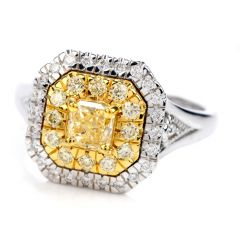 GIA 0.65 carat Fancy Yellow Diamond 18K Gold Halo Engagement Ring